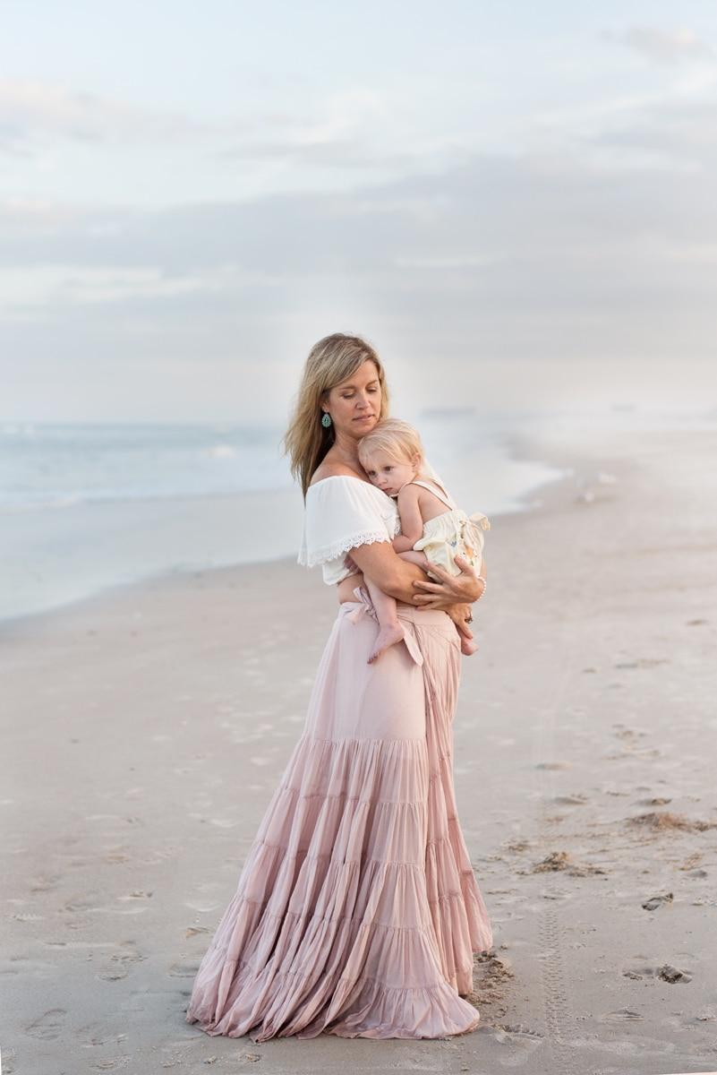 Mom holding baby in Galveston