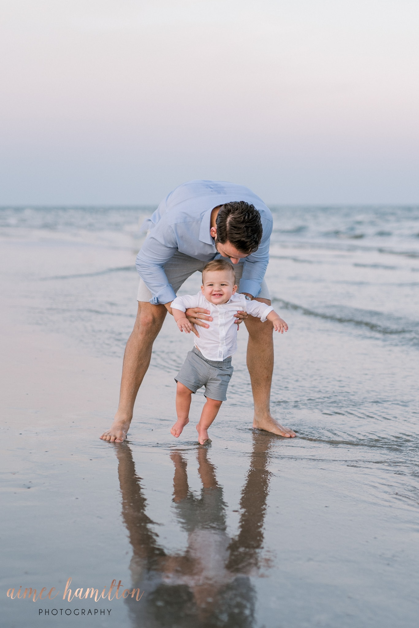 Father and son beach portraits in Galveston