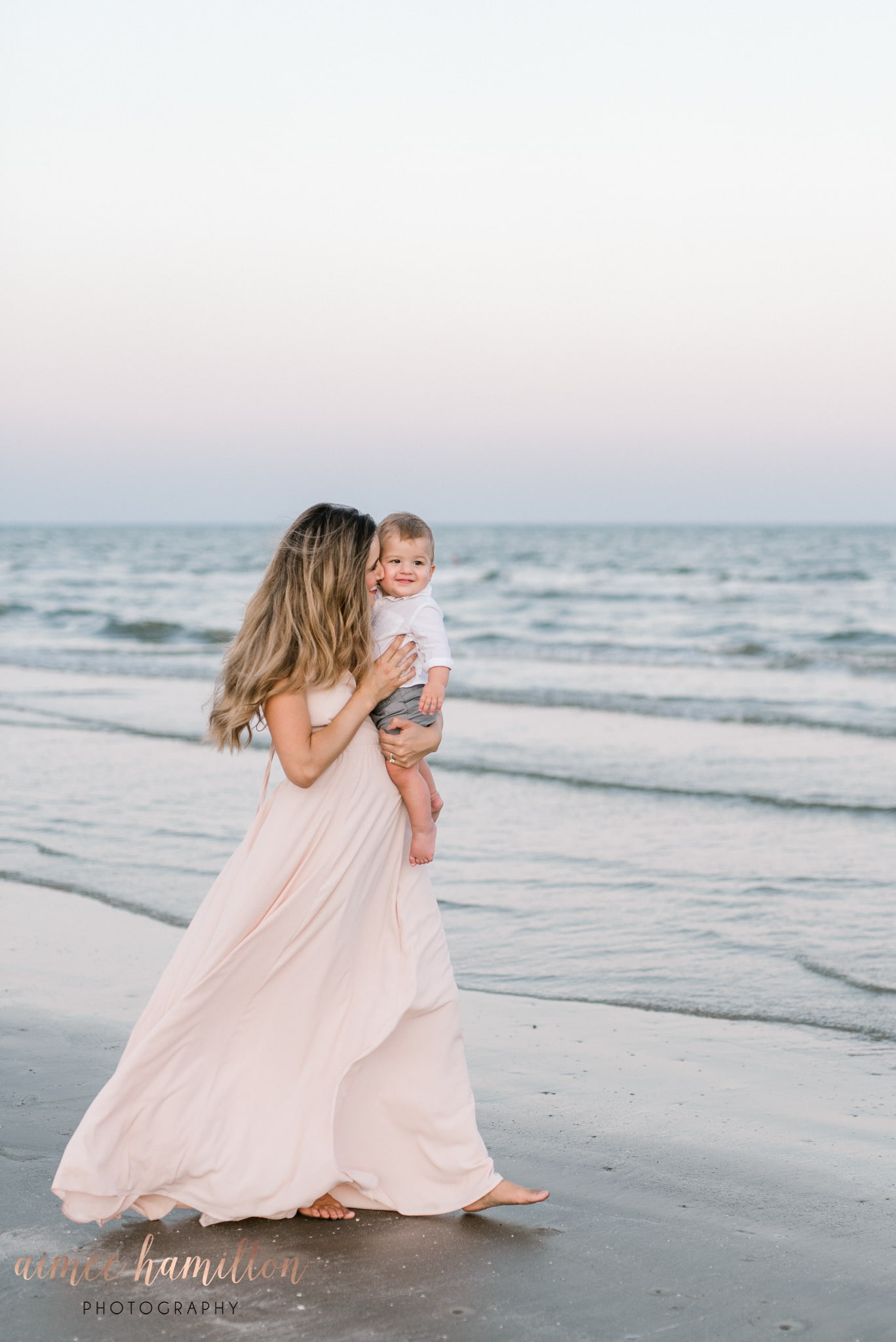 Mother and baby portraits on the beach in Galveston