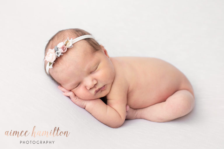 simple newborn girl pose