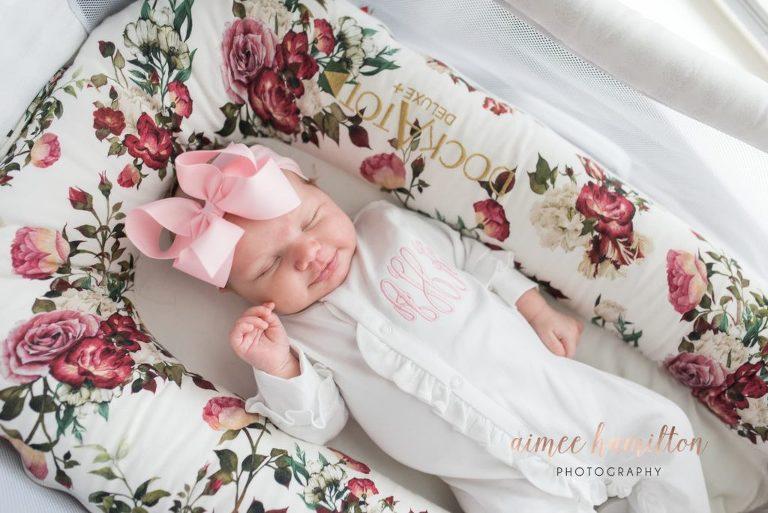 Newborn sleeping in dockatot