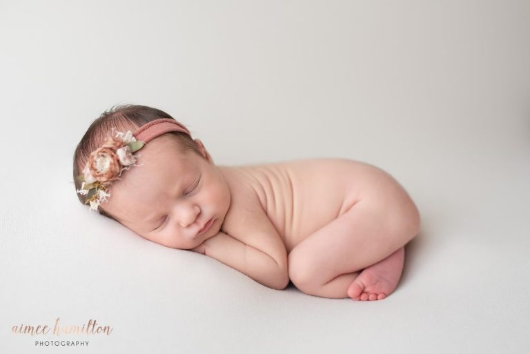 Newborn Posed on soft fabric in Houston studio