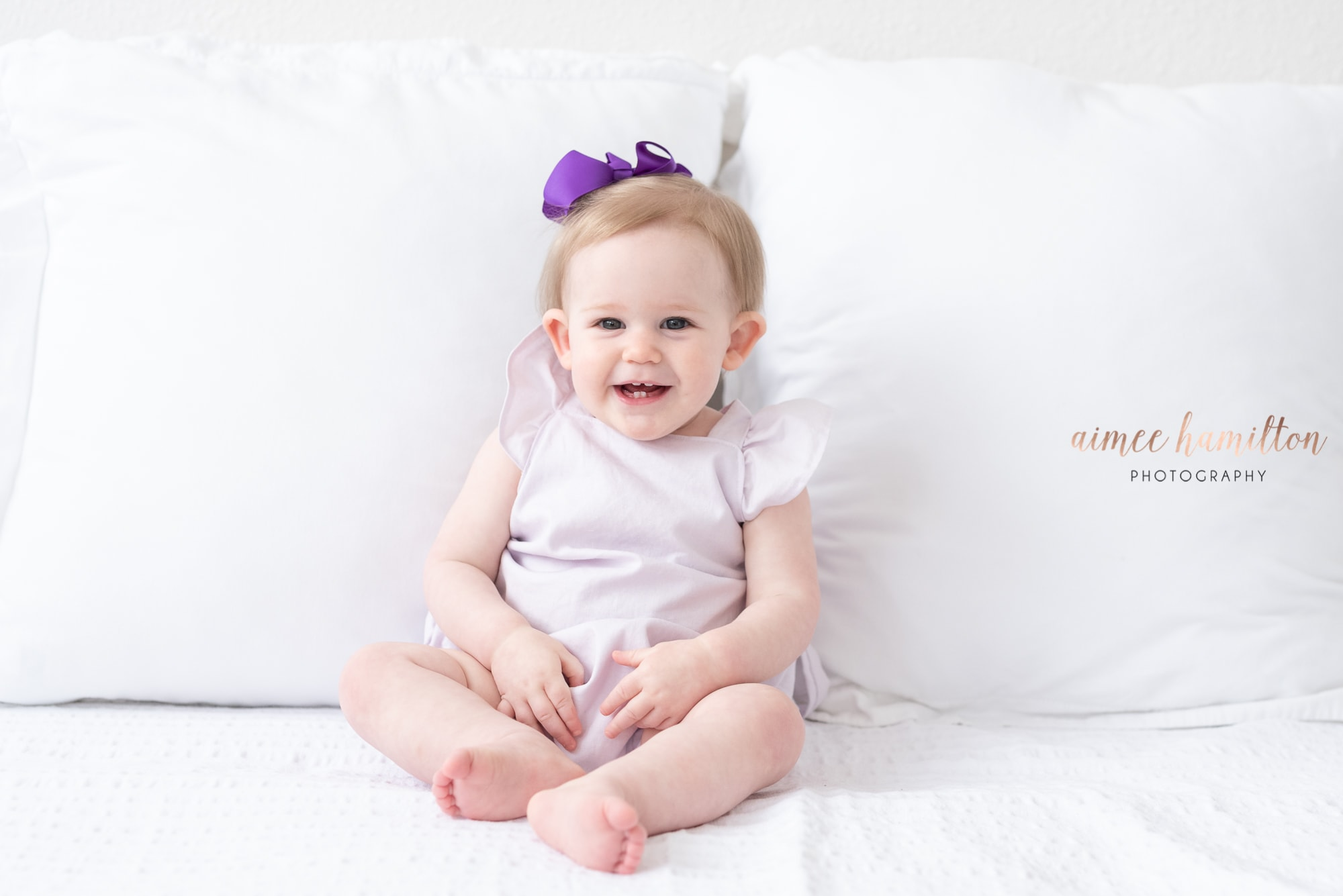 Baby on white bed in Houston area studio