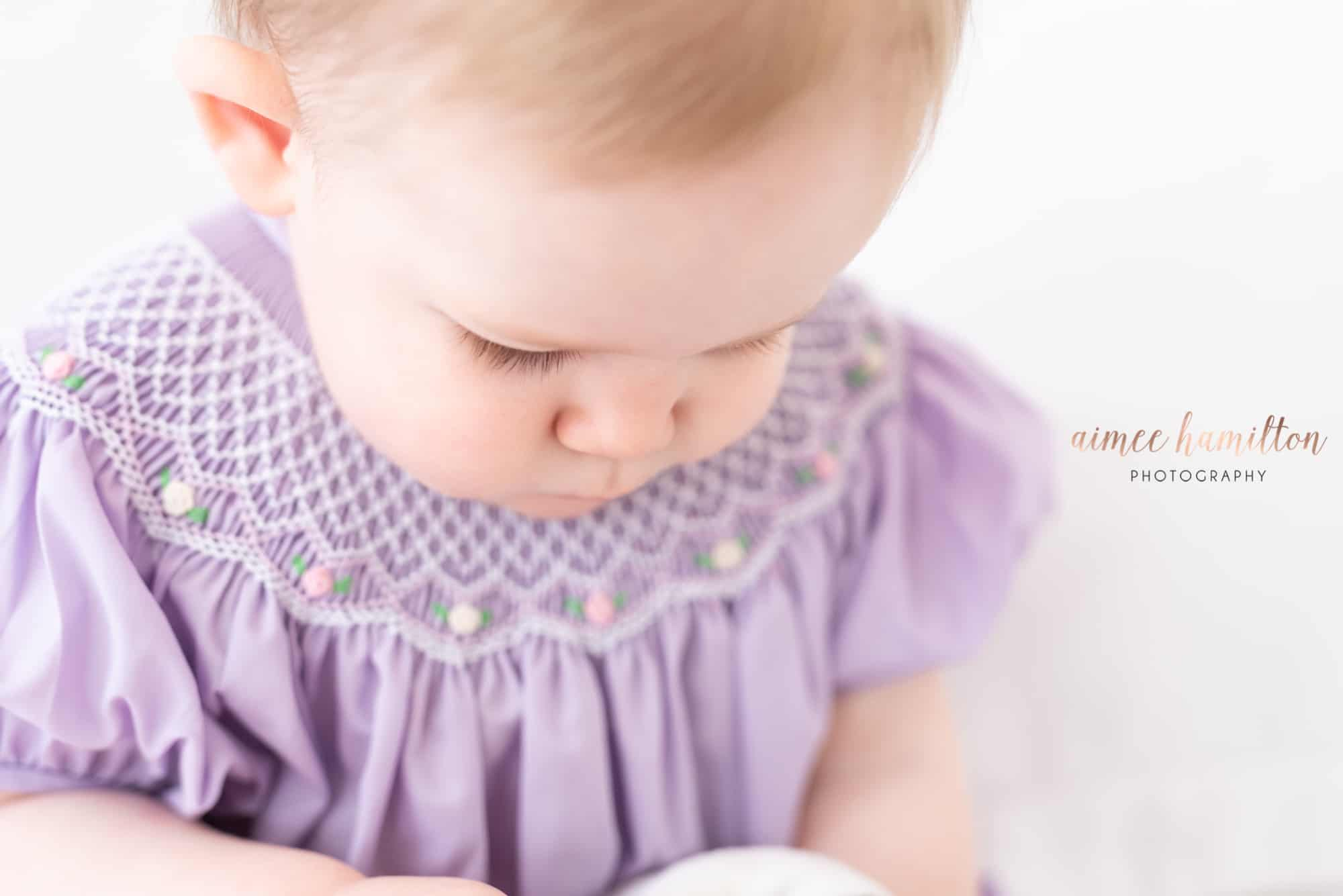 Close up of baby girl in smocked dress