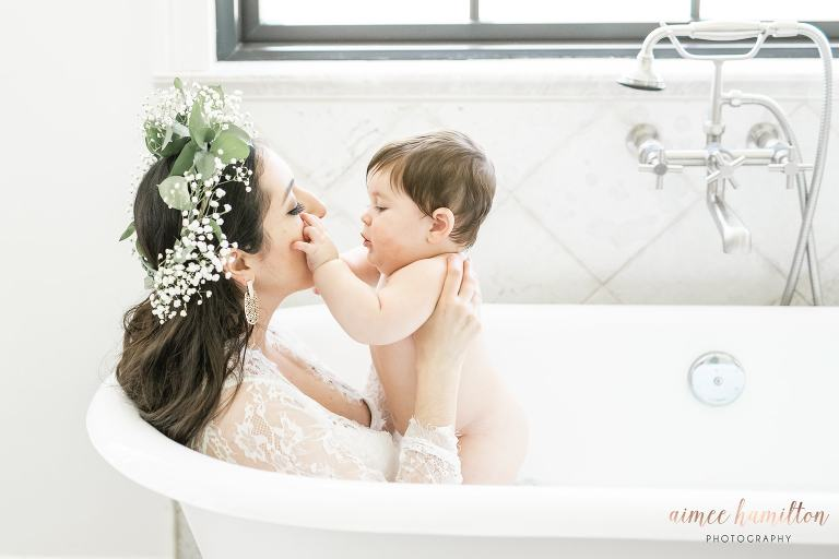 Baby boy plays with his mom in Houston milk bath