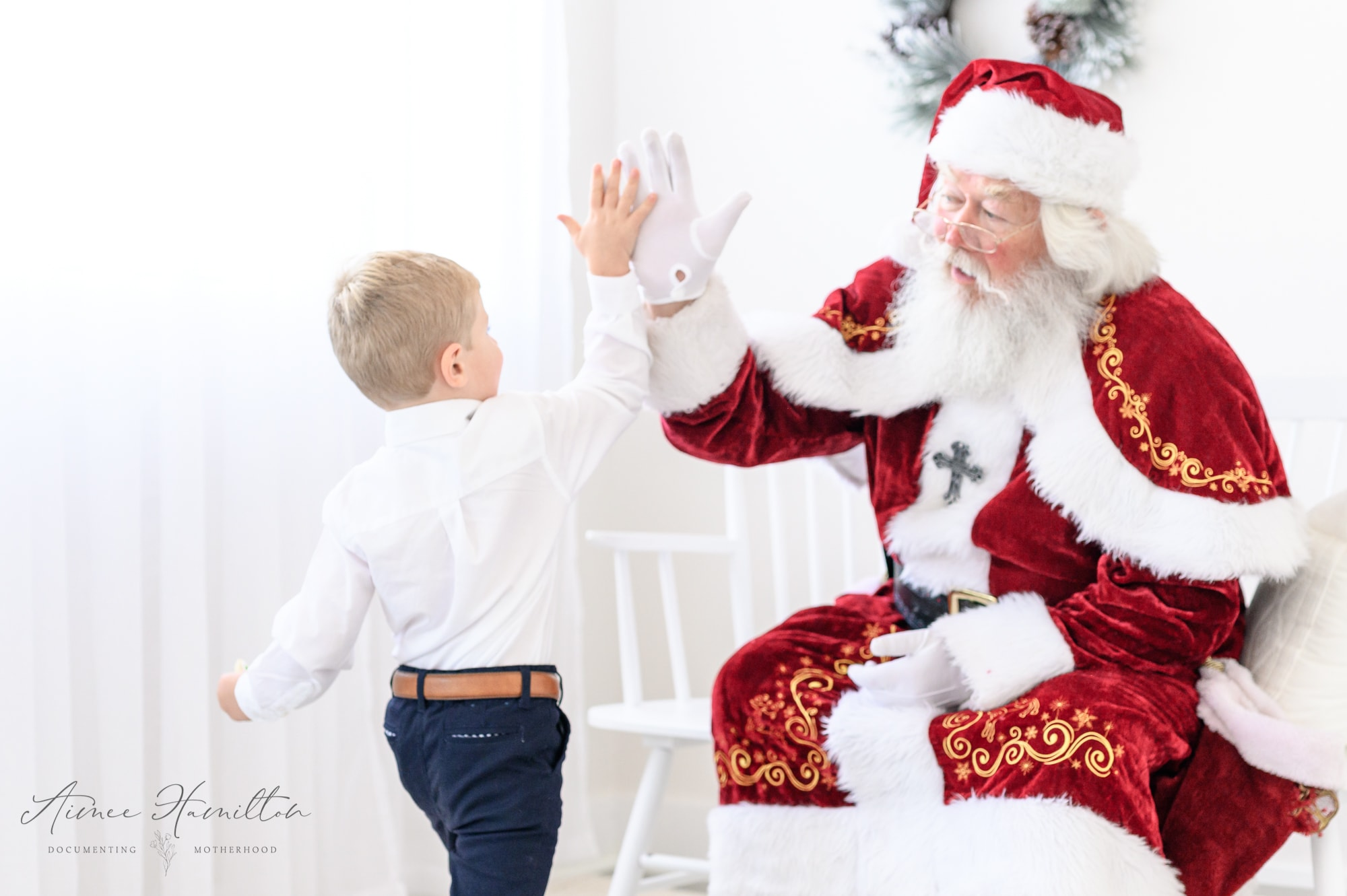 Kid high fives Santa
