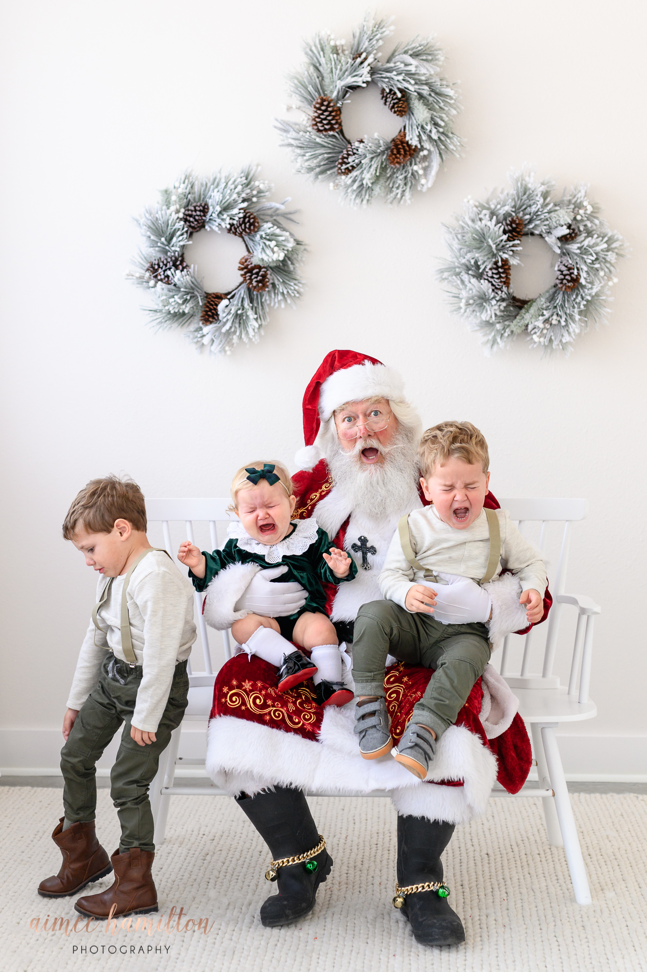 Santa and crying siblings