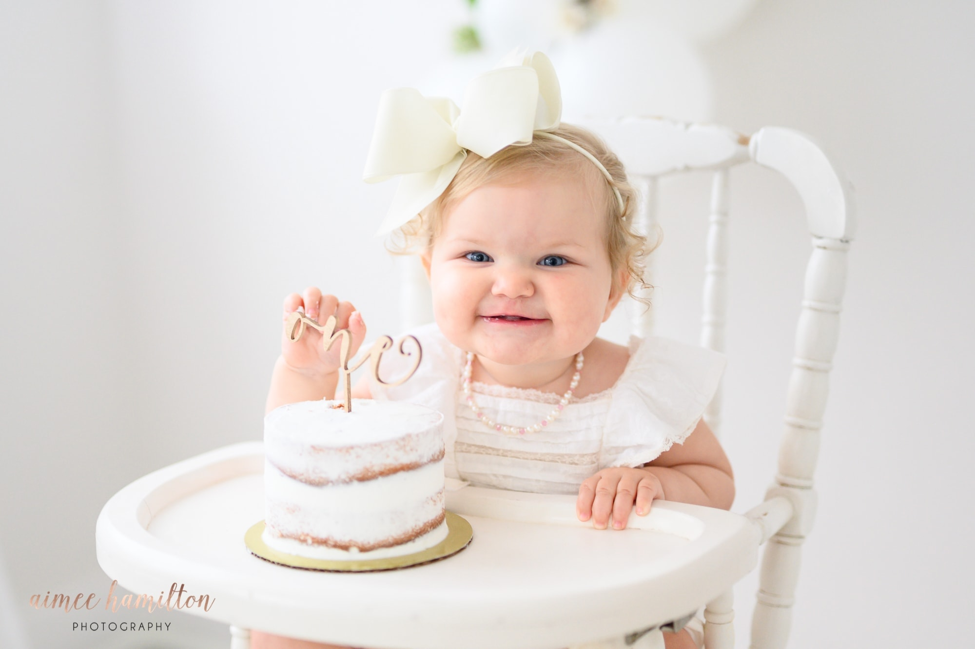 baby smiling with her cake