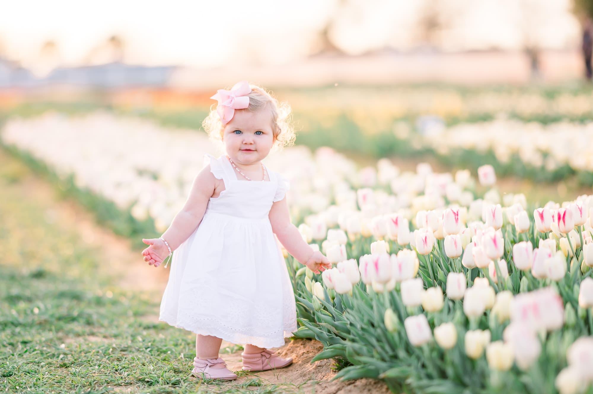 baby girl posing at Texas tulip farm