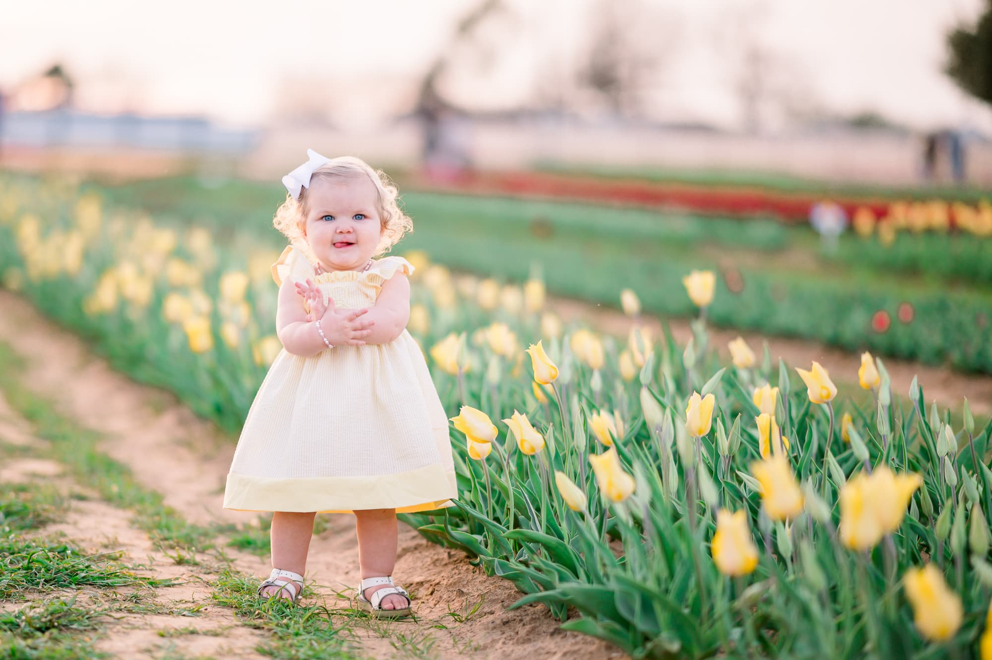 Spring tulips with baby girl