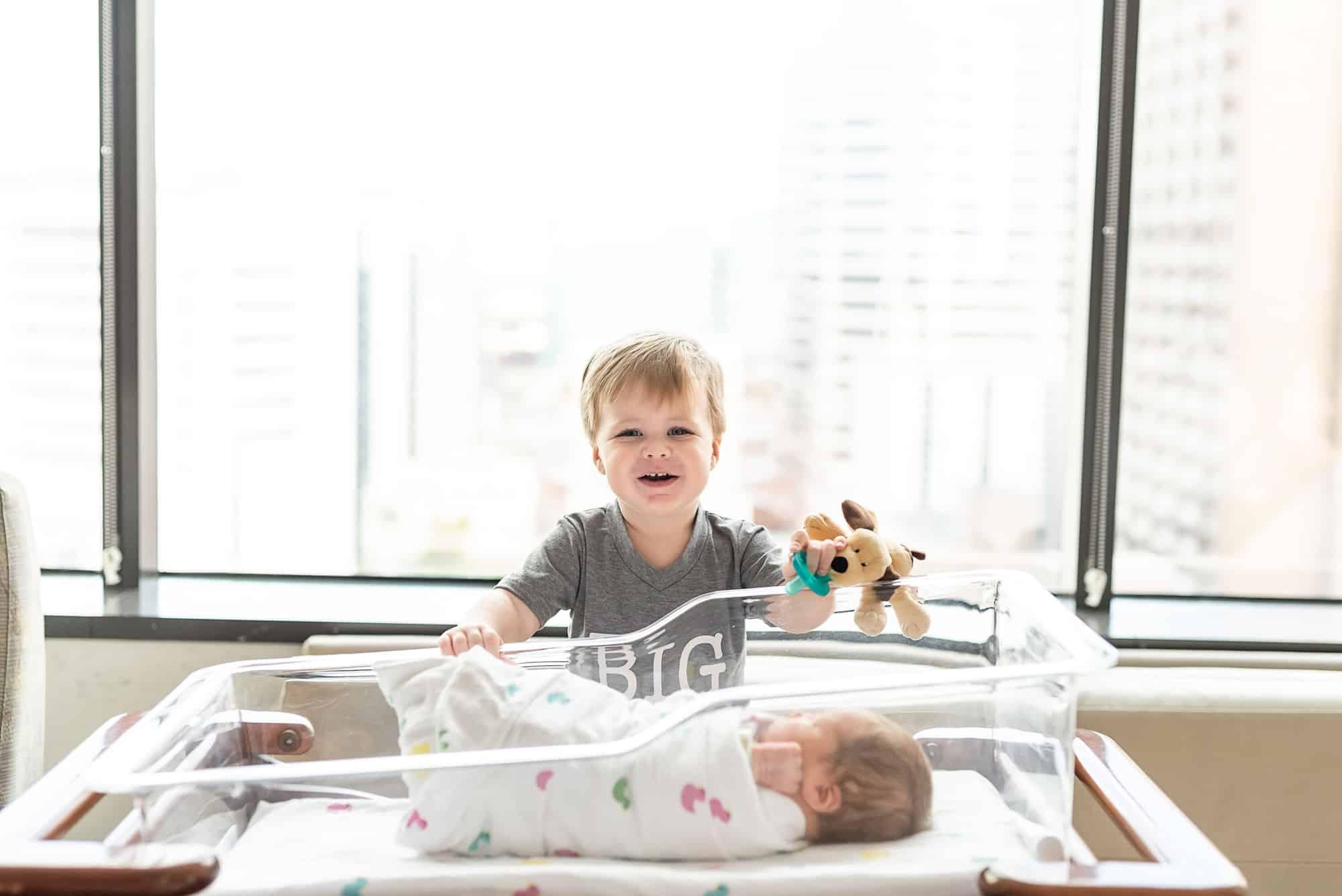Big brother meeting newborn sibling