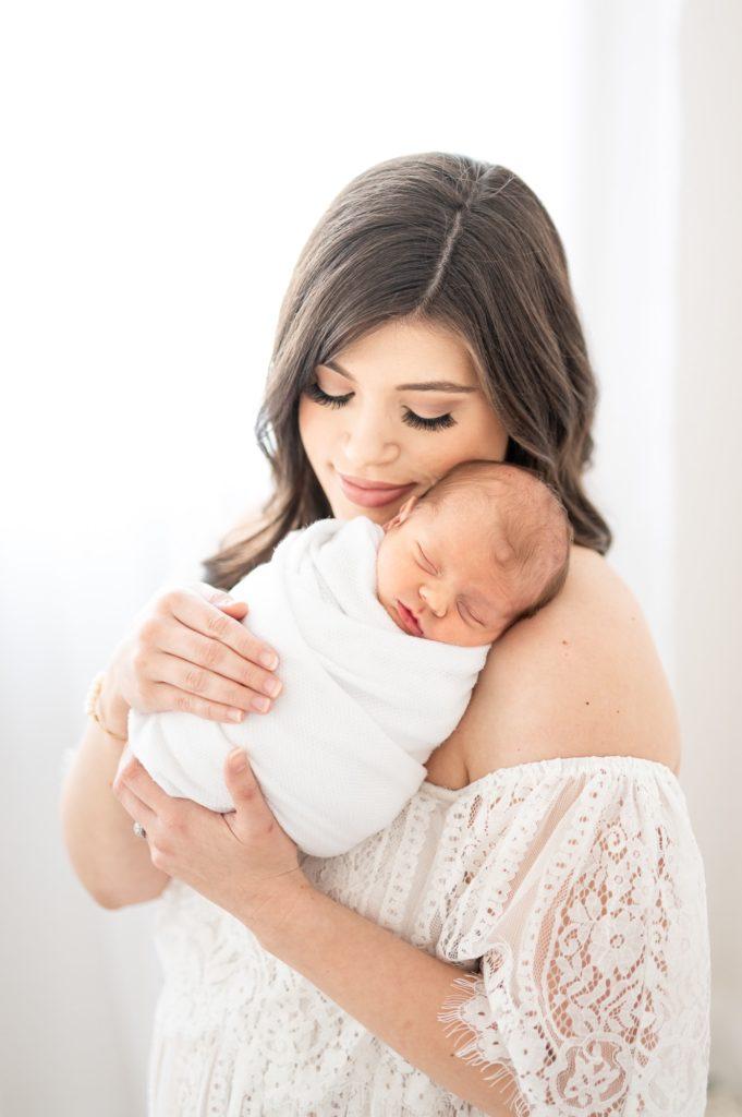 Mom snuggles baby boy