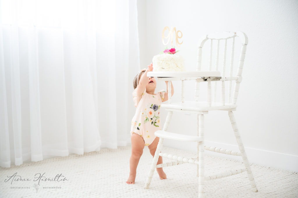 Baby reaches for cake