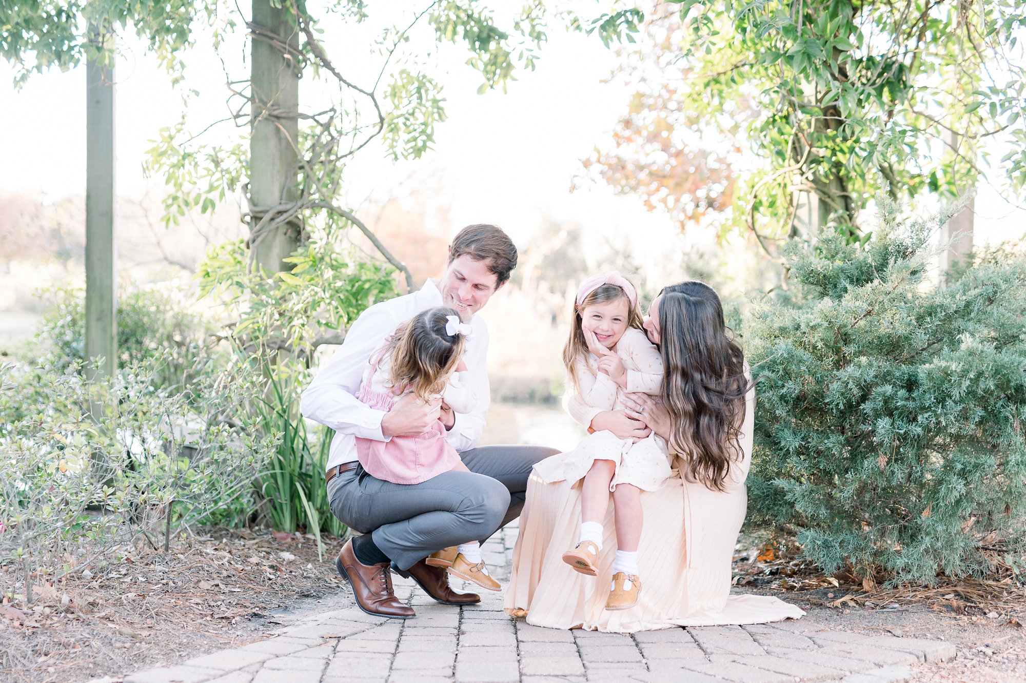 Family cuddling during portrait session with McKinney family photographer, Aimee Hamilton Photography.