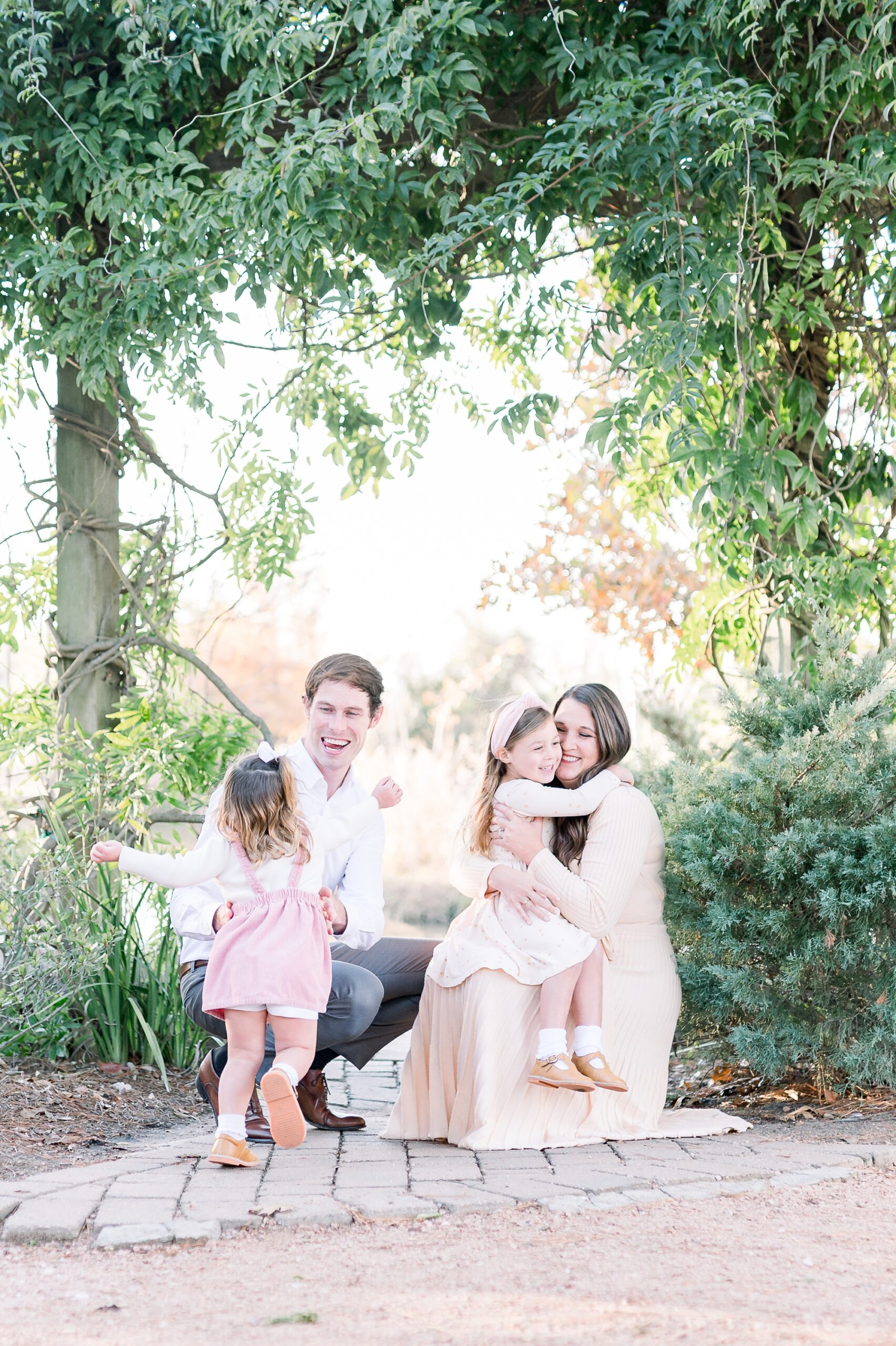 Family session in park with two toddlers in McKinney, TX. Photo by Aimee Hamilton Photography.