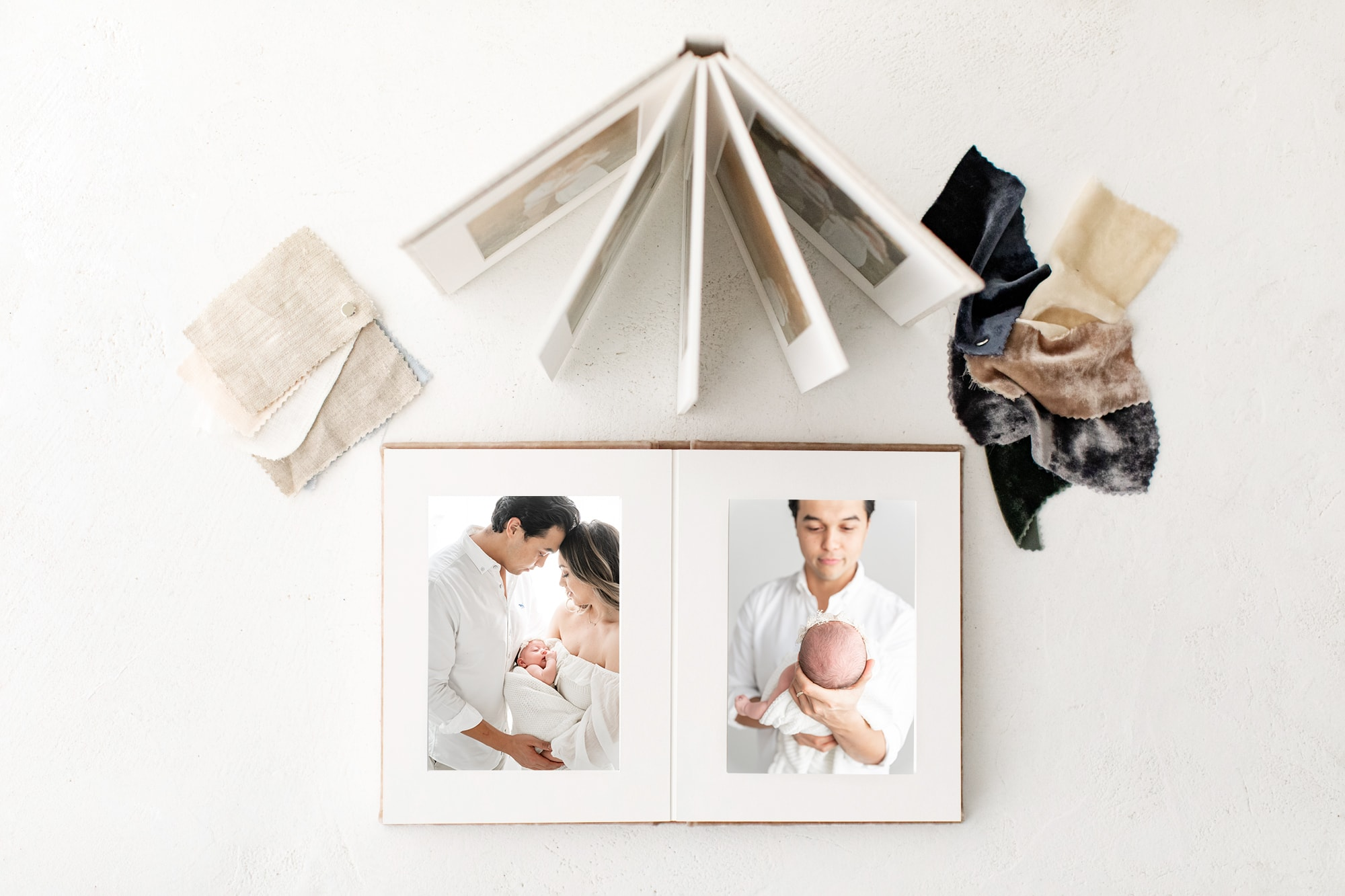 Dallas photographer offers albums for family and newborn portraits