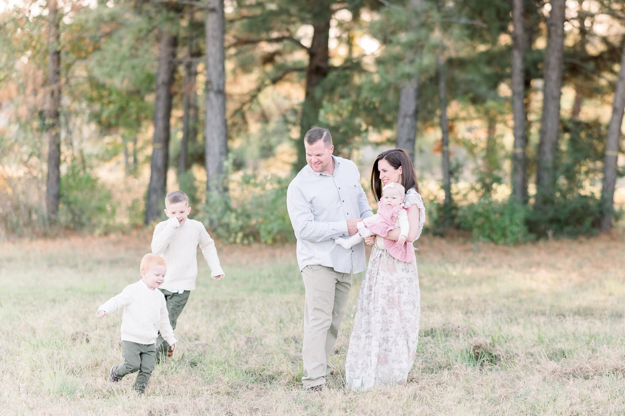 Toddlers playing chase during family session by Dallas TX family photographer, Aimee Hamilton Photography.