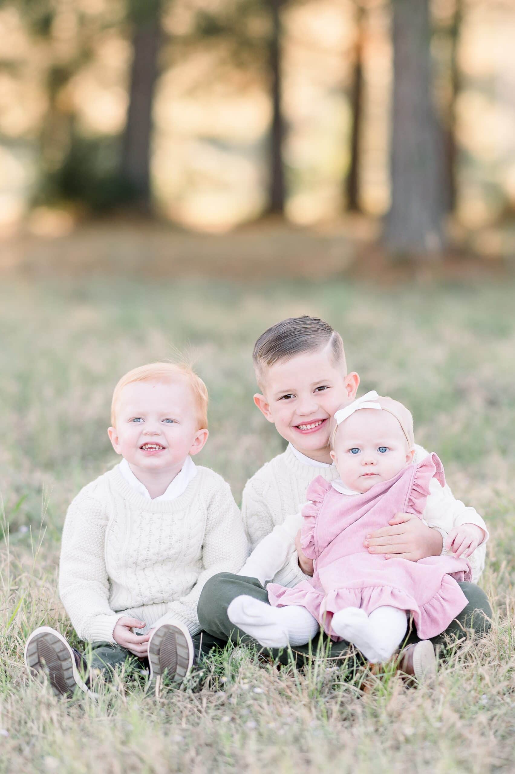 Photo of three siblings during sunset family session. Photo by Dallas TX family photographer, Aimee Hamilton Photography.