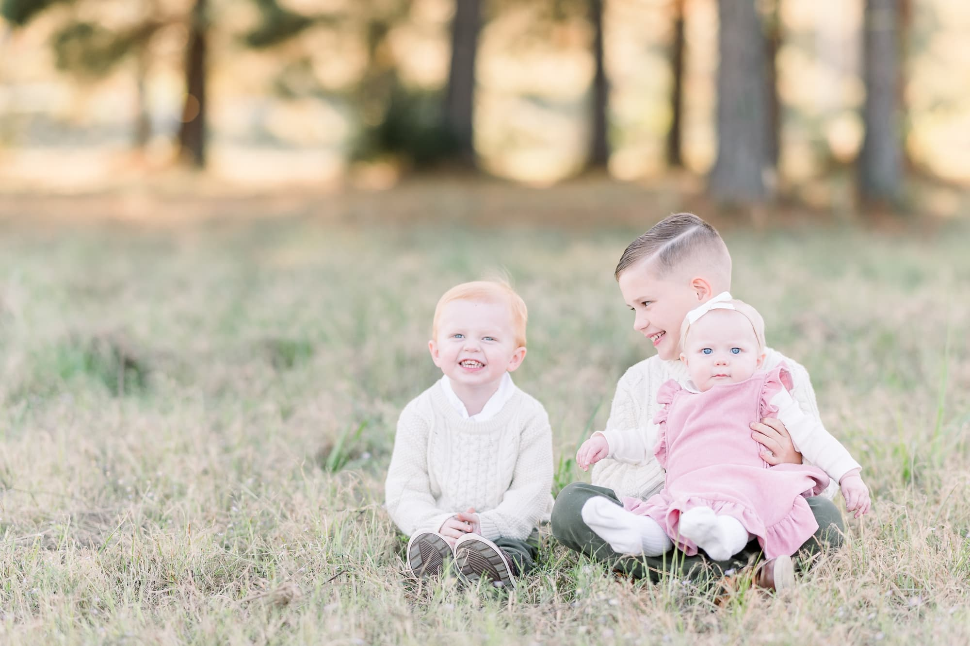 Candid photo of three siblings during sunset session. Photo by Aimee Hamilton Photography.
