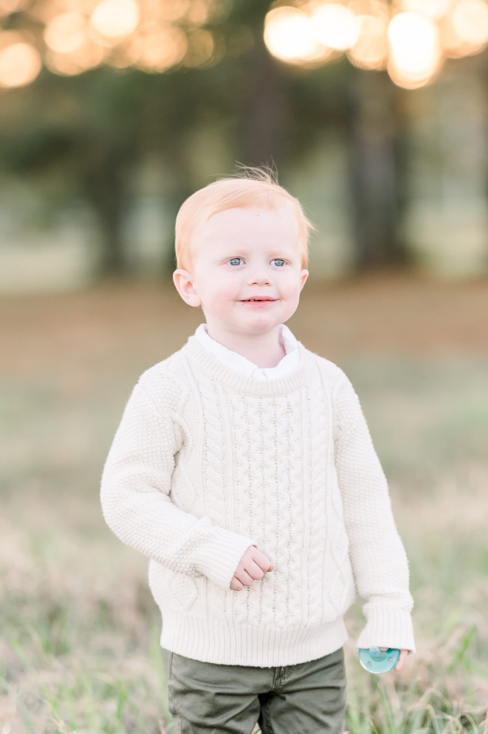 Toddler smiling at camera during photo session with Aimee Hamilton Photography.