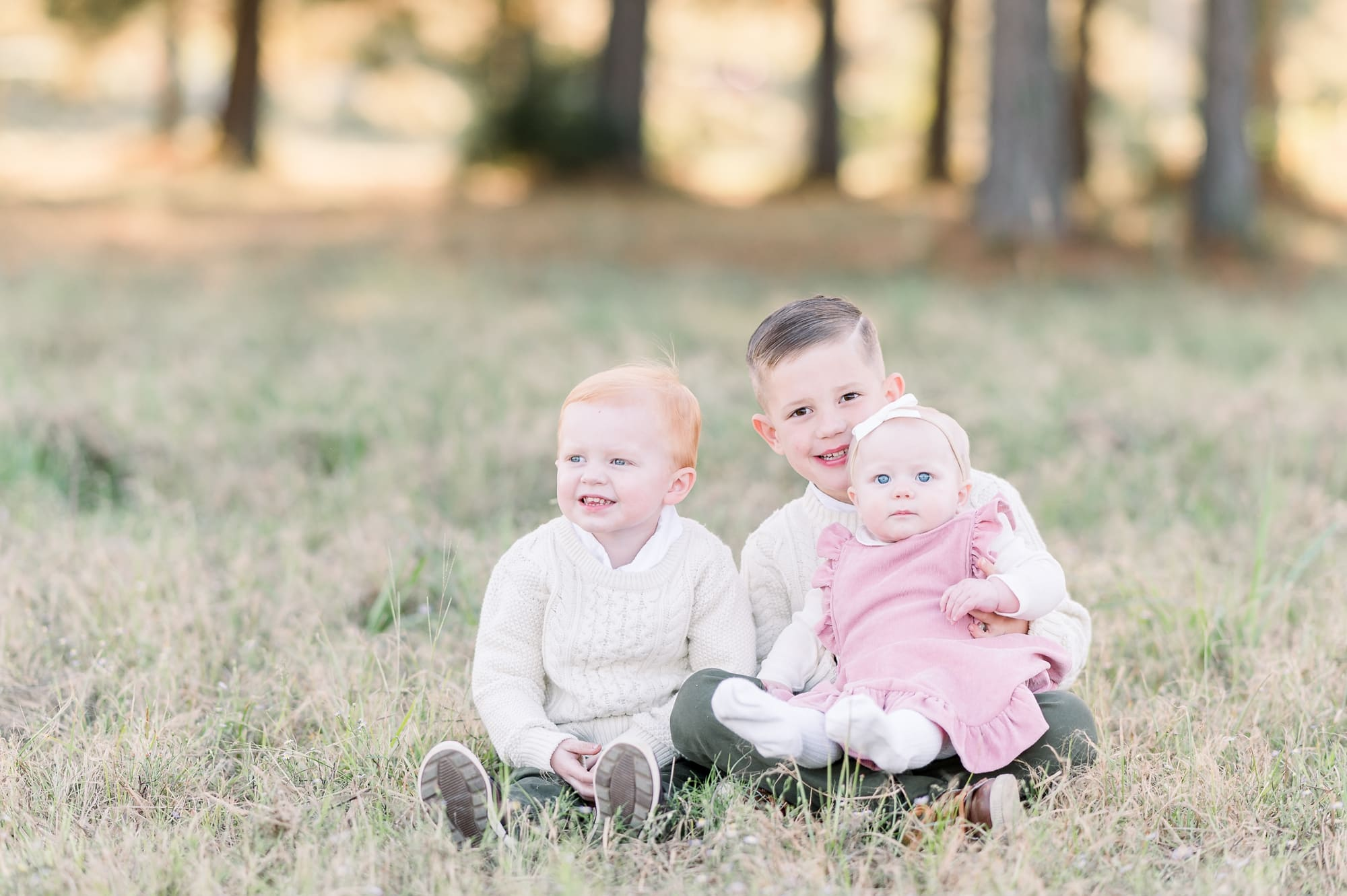 Three kids smiling at camera during family session by Dallas TX family photographer, Aimee Hamilton Photography.