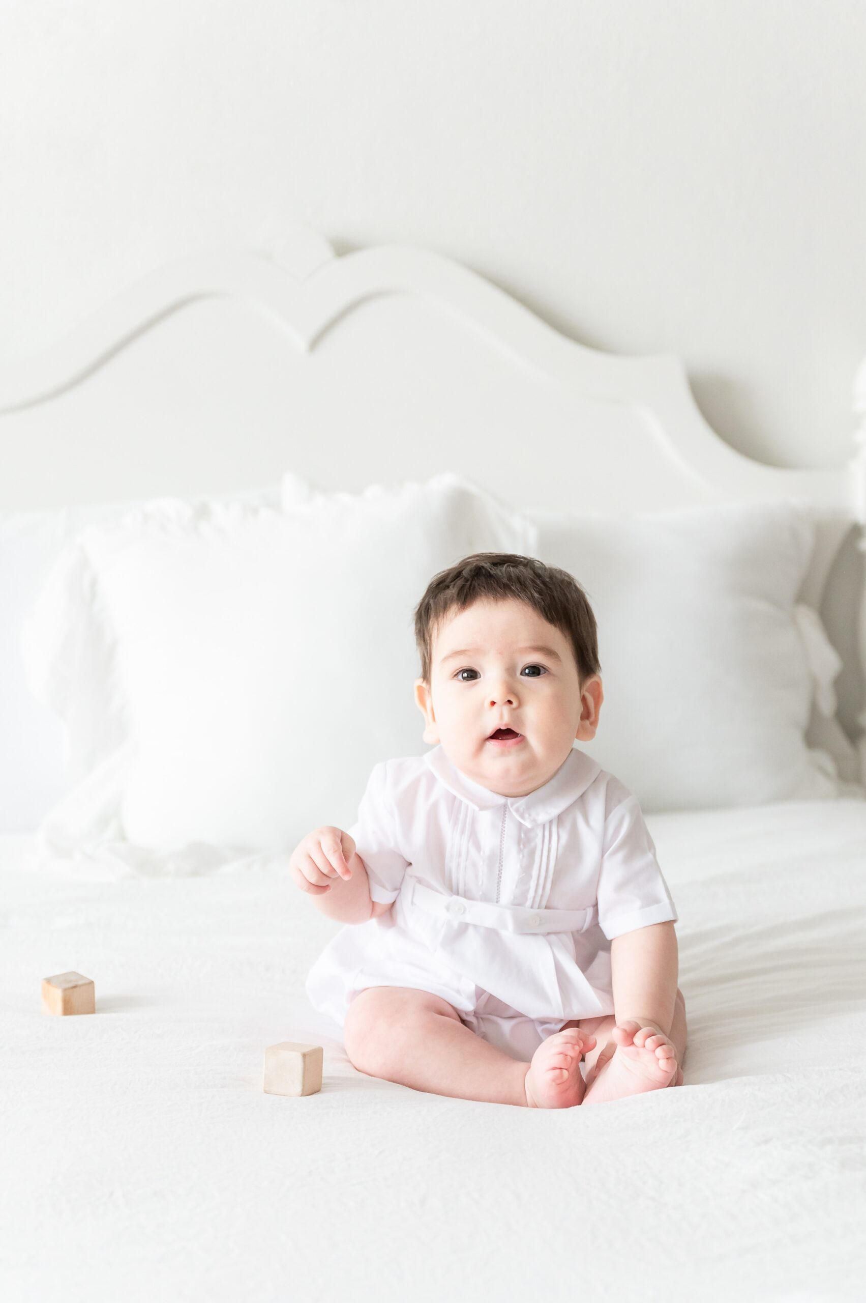 Baby boy in Feltman Brothers outfit during sitter milestone session. Photo by Aimee Hamilton Photography