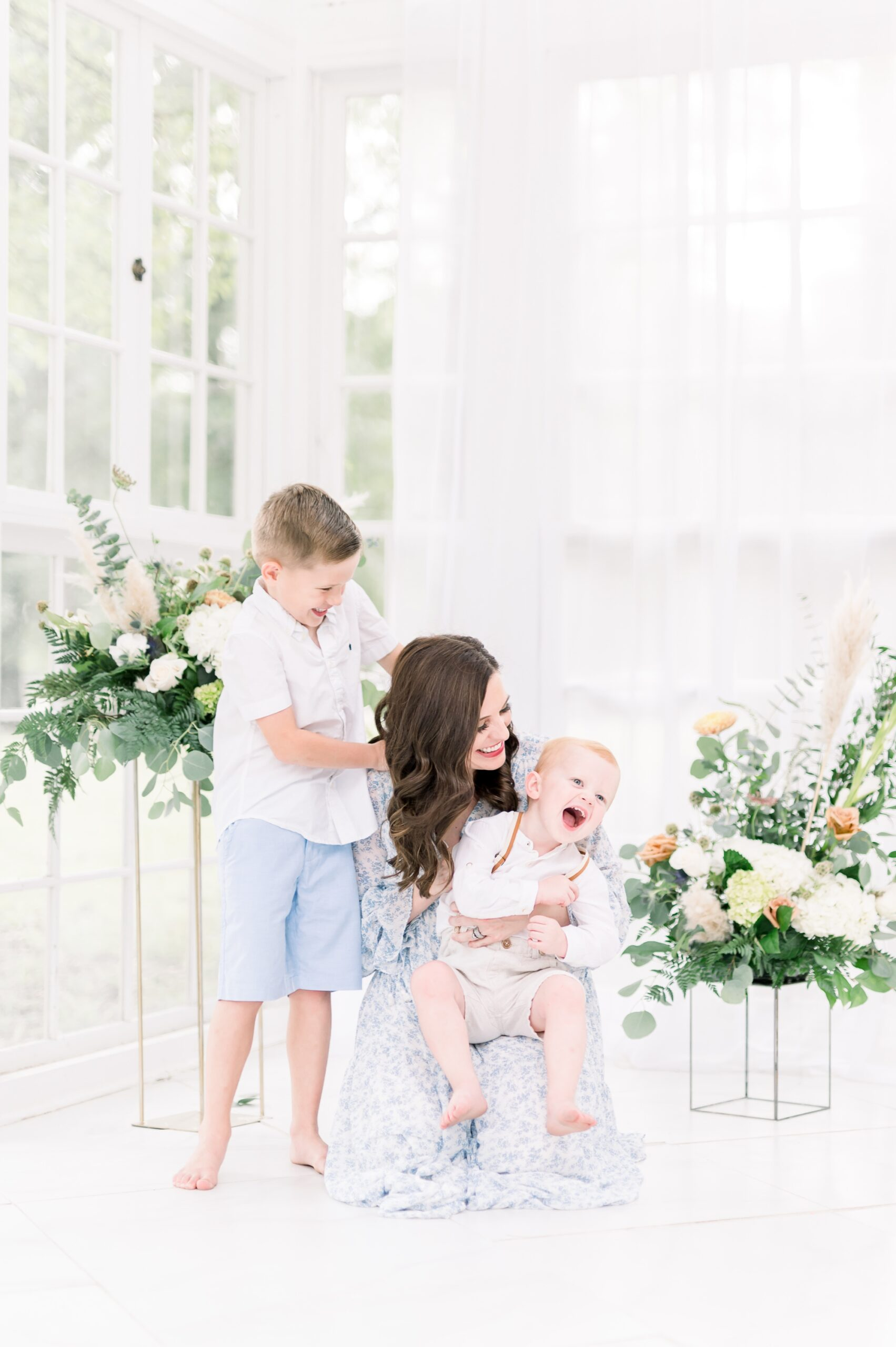 Mom with two boys laughing together during motherhood session. Photo by Dallas family photographer, Aimee Hamilton Photography.