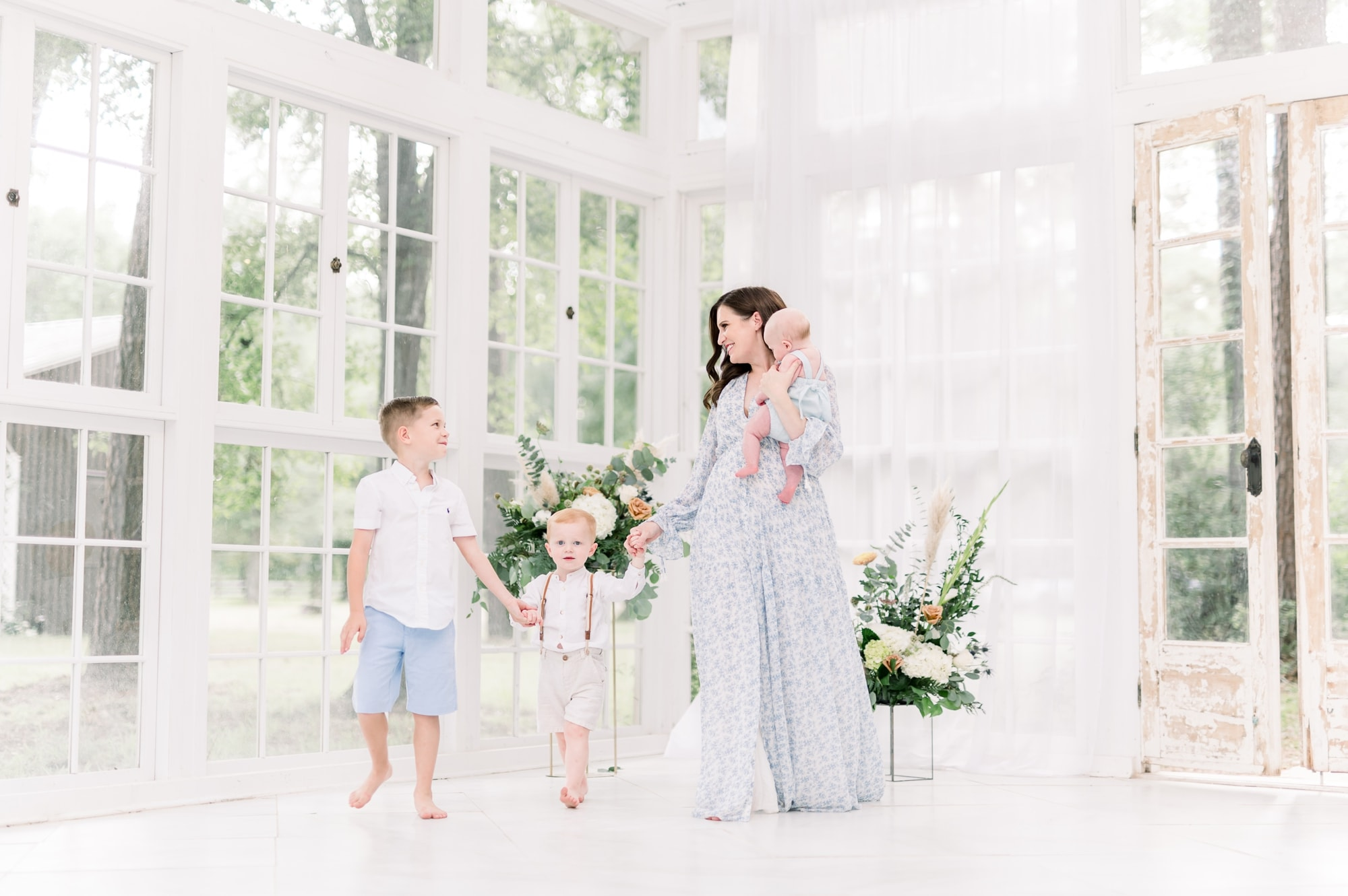 Mom wearing blue floral maxi dress with three children during motherhood mini session with Aimee Hamilton Photography.
