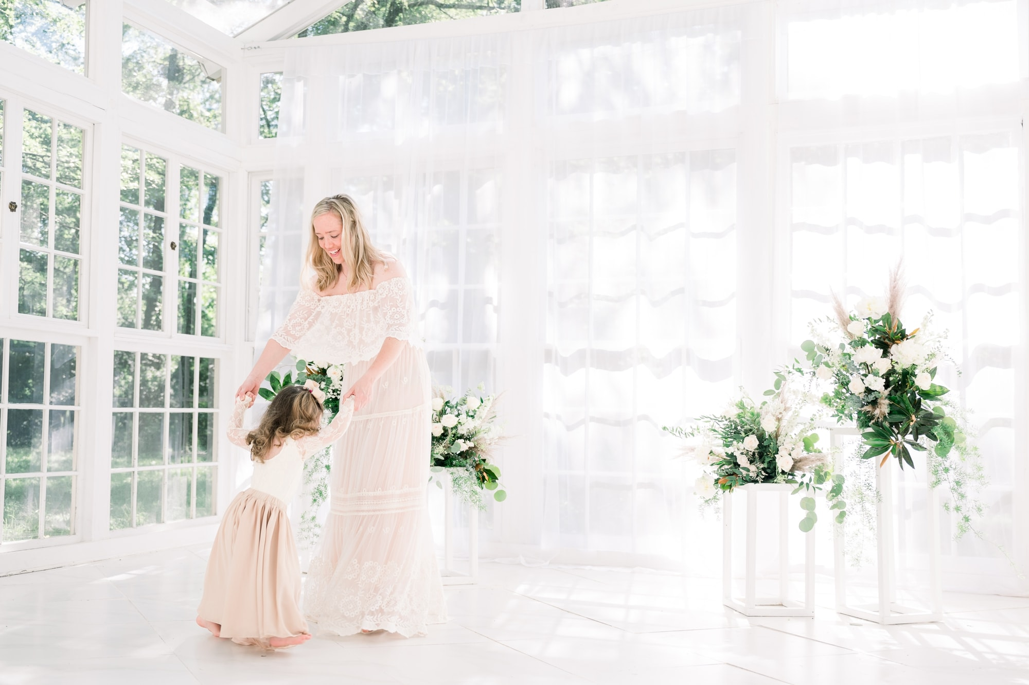 Mom wearing lace maxi dress dances with little girl during motherhood session. Photo by Dallas family photographer, Aimee Hamilton Photography.