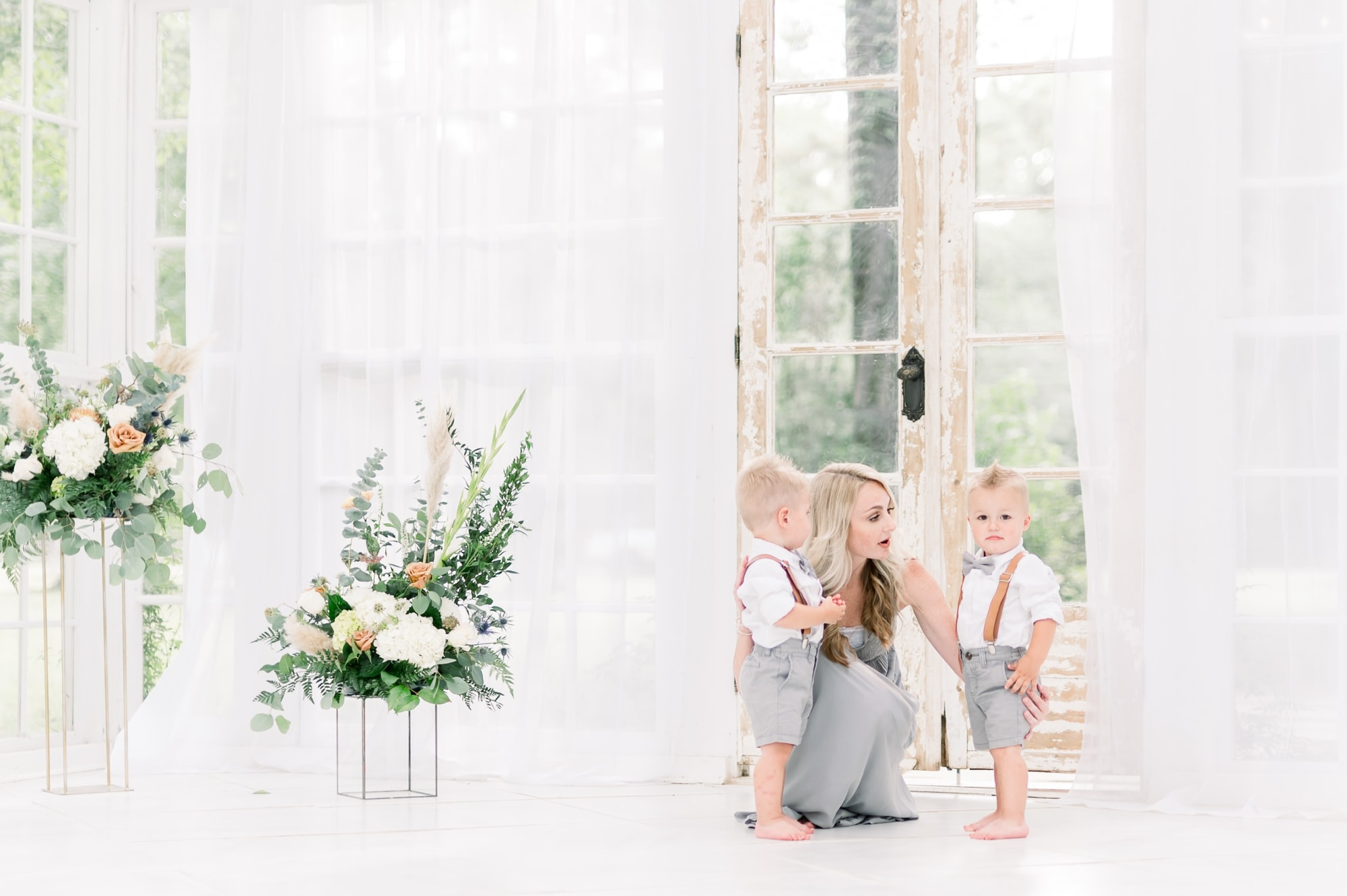 Mom with two boys during motherhood mini session. Photo by Dallas family photographer, Aimee Hamilton Photography.