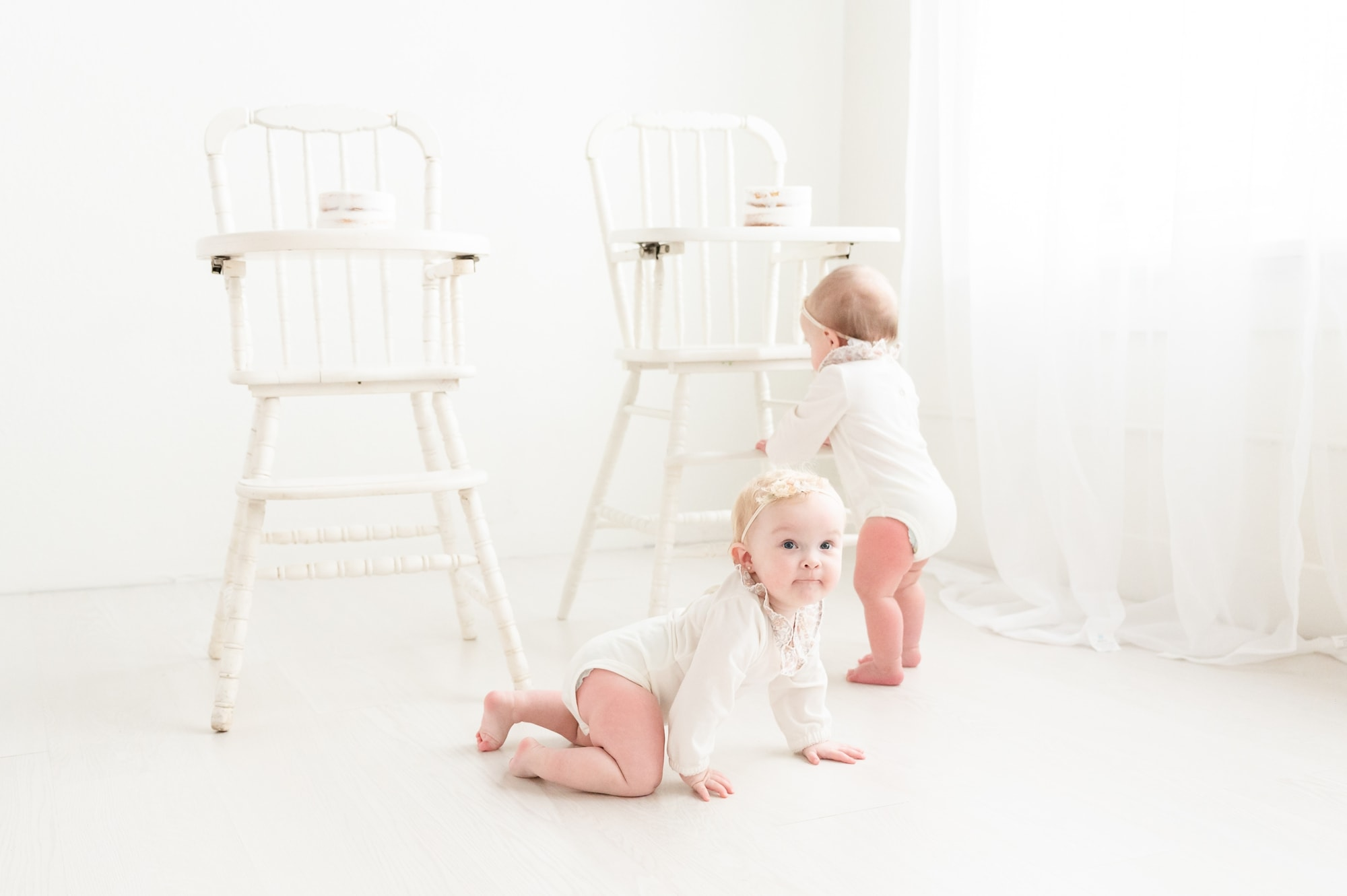 Cake smash session with two white highchairs for twins. Photo by Dallas studio baby photographer, Aimee Hamilton Photography.